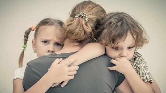 mom-hugging-children